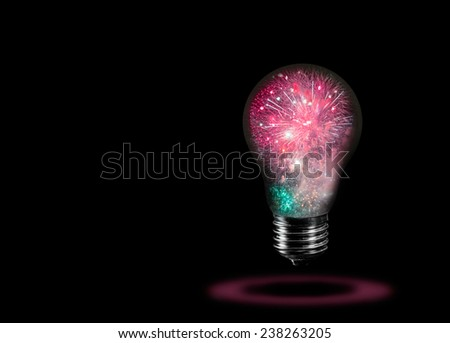 glowing light bulb with fireworks - stock photo