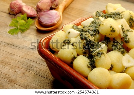 gnocchi with spices on the kitchen - stock photo