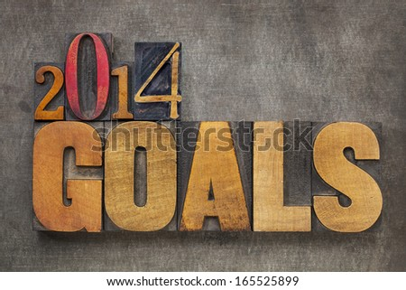 2014 goals - New Year resolution concept - text in vintage letterpress wood type blocks against grunge metal - stock photo