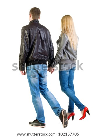 going young couple (man and woman) Back view. walking friendly girl and guy in jacket and jeans together. Rear view people collection.  backside view of person.  Isolated over white background - stock photo