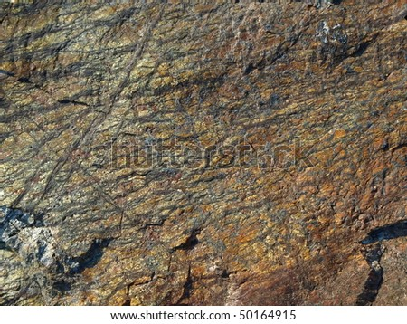 gold and copper stone wall background - stock photo
