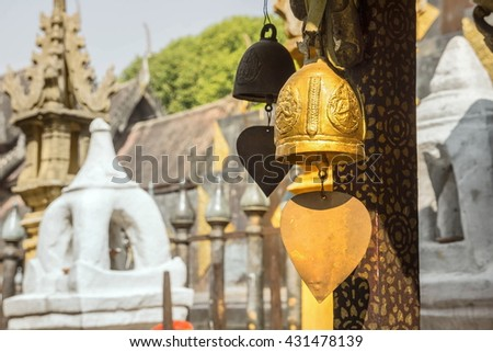 Golden Bells hanging in the temple. - stock photo