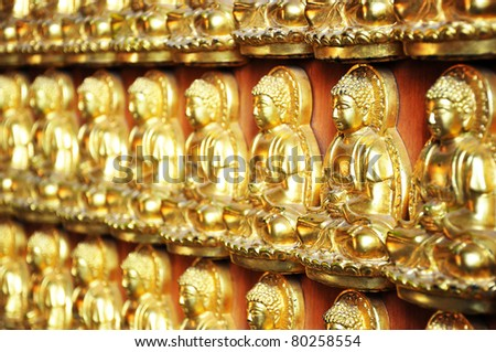 10000 Golden Buddha in Chinese temple - stock photo