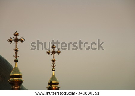 Golden crosses on the top of church - stock photo