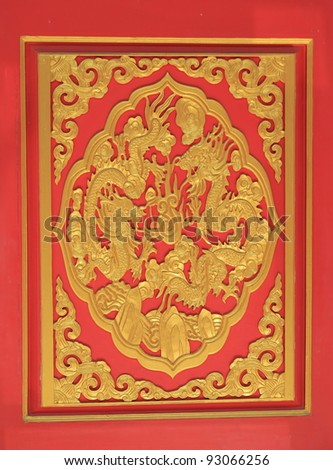 golden dragon on red wood in chinese temple - stock photo