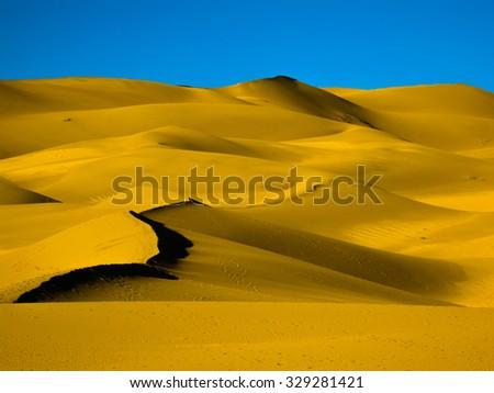 Golden sunrise, Great Sand Dunes, Colorado, USA - stock photo