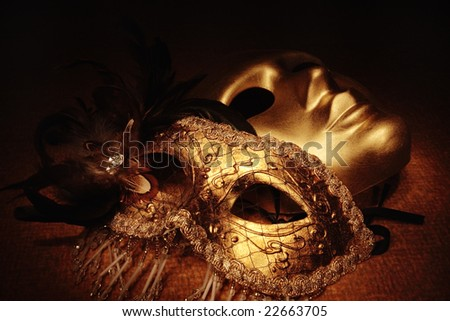 golden venetian masks on a textile