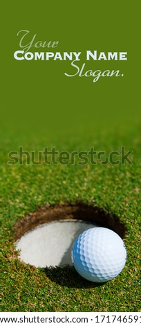 Golf ball close to the hole  - stock photo