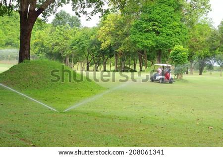 Golf course sprinkler - stock photo