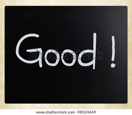 """Good"" handwritten with white chalk on a blackboard"
