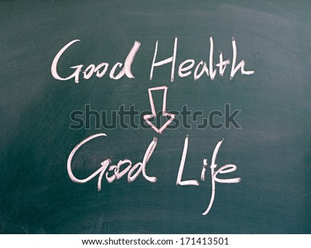 """good health and good life"" word written on blackboard - stock photo"