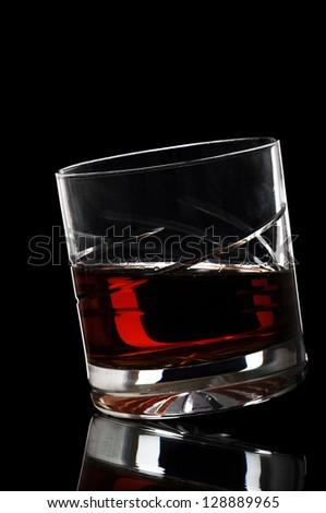 gorgeous glass of whiskey isolated on black background - stock photo
