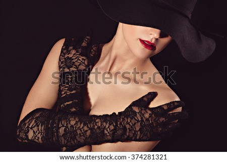 Graceful woman in hat and lace gloves - stock photo