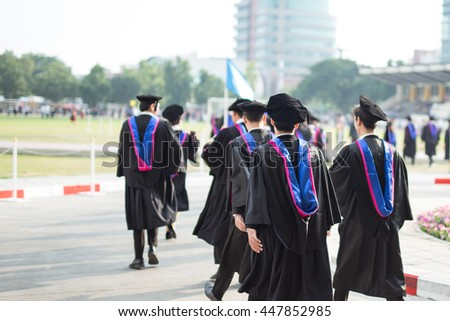 Graduates are walking in line to get your degree,Congratulations - stock photo