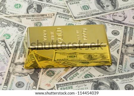 1000 grams or kilo golden bar or ingot on background of hundred - stock photo