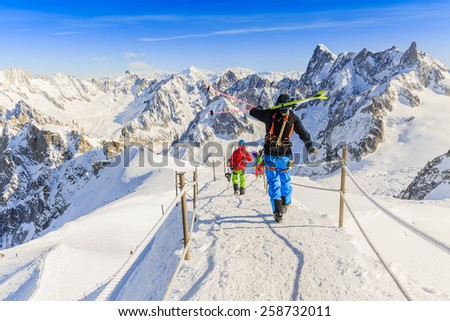 Grand Jorasses and freeriders, extreme ski, Aiguille du Midi, French Alps - stock photo