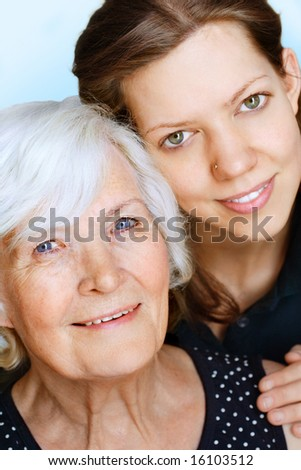 Grandmother and granddaughter together for a portrait - stock photo