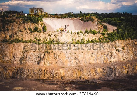 granite quarry with the machines to work, view - stock photo