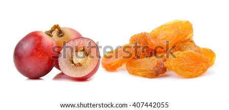 grape and Dried raisins on a white background - stock photo