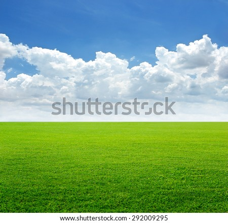 grass field and cloud with blue sky background, soft focus - stock photo