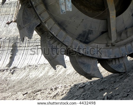 Great mining wheel of coal digger - stock photo