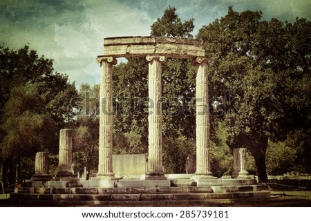 Greece Olympia, ancient ruins of the important Philippeion in Olympia,  UNESCO world heritage site. Filtered image, vintage effect applied    - stock photo