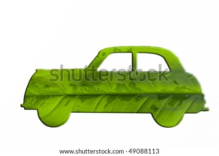 Green car cut from leaf. Check out my gallery for more eco images. - stock photo