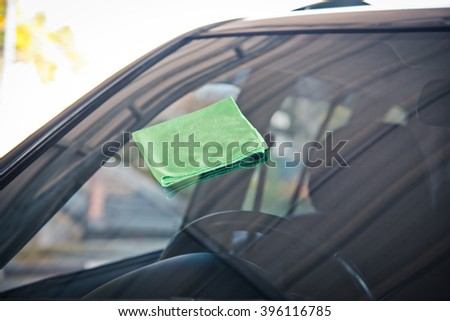 green microfiber cloth, cleaning glass car.  - stock photo