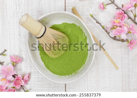 Green  tea . Still life with green tea powder and bamboo whisk. Japanese Tea Ceremony: Preparation of powdered green tea - stock photo