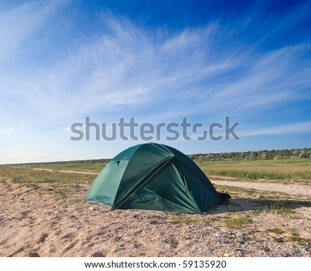 green touristic tent in a steppe