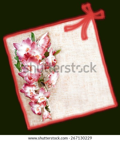 Greeting floral card  with pink orchid flowers on burlap background , border,ribbon and bow  - stock photo