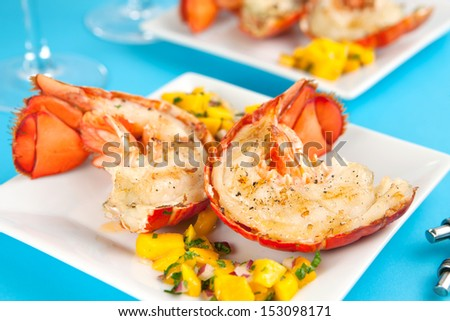 Grilled lobster tails with mango salsa - stock photo