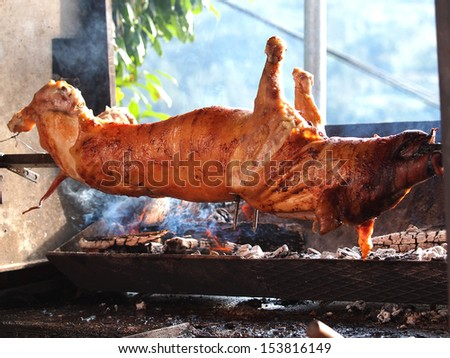 grilled pig on the broach     - stock photo