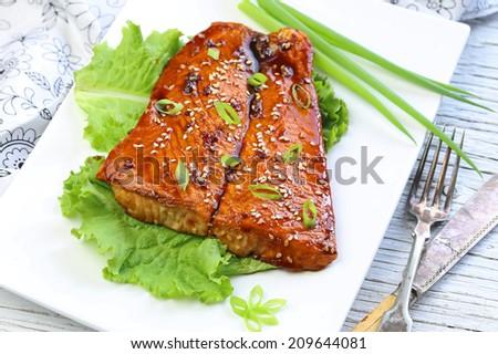 Grilled salmon with teriyaki sauce - stock photo