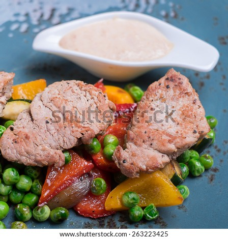 Grilled steak with assorted vegetables, selective focus - stock photo