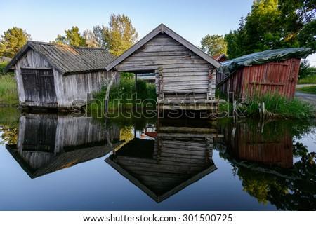 29.07.2015 - Grisslehamn, Sweden - Old boat houses sit along the harbor in Grisslehamn, Sweden - stock photo