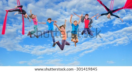 Group happy dancing jumping and aerial silks performing together children in blue sky. Photo collage. Childhood, active lifestyle, sports and happiness concept.           - stock photo