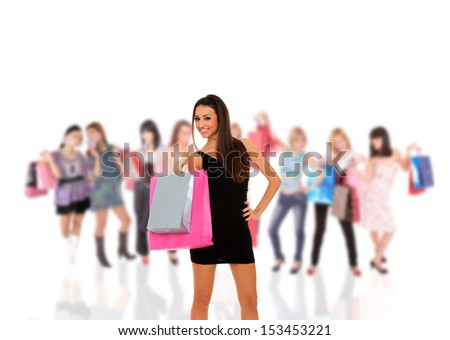 Group of beautiful young shopping women with girls holding bags