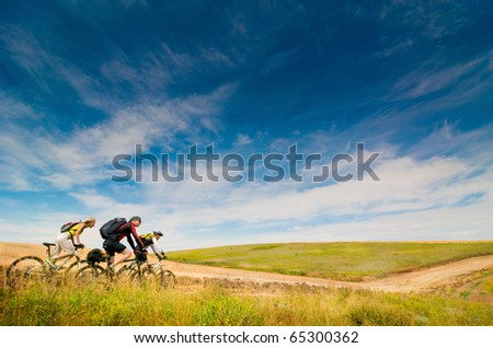 group of cyclists biking - stock photo