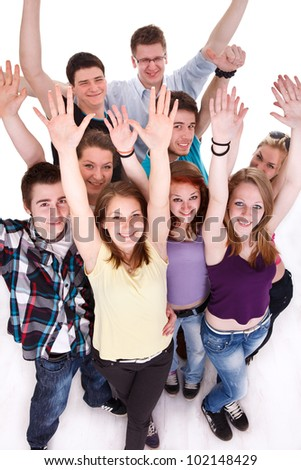 Group of happy teenagers, smiling and looking at camera with hands arms up, top view - stock photo
