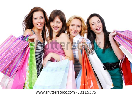 group portrait of four happy young adult girls with colored bags - stock photo