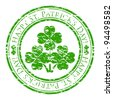 grunge rubber stamp with four-leaves clover and text (happy st. patrick's day written inside the stamp) isolated on white background - stock photo