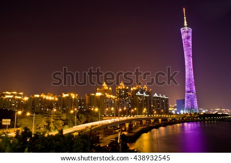 Guangzhou,October, 2014--The night scenic of Guangzhou, the tower with colorful neon light over the Pearl River. - stock photo