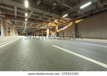 guangzhou tower below , abstract city road background - stock photo