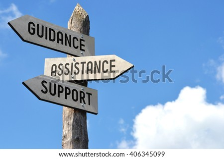 """""""Guidance, assistance, support"""" - wooden signpost, cloudy sky - stock photo"""