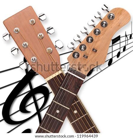 2 guitar heads on music sheet - stock photo