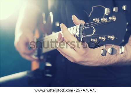 Guitarist on stage in the stage light - retro photo - stock photo
