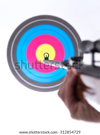 gun aiming at a target - stock photo
