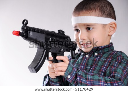 gun kid - stock photo