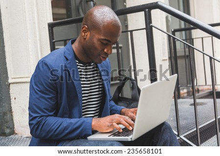Guy Using Notebook in New York